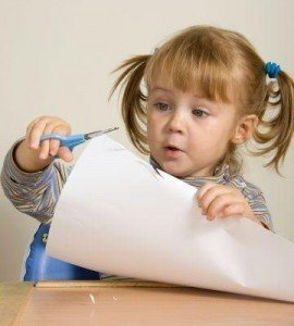 girl cutting paper